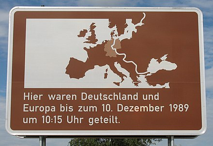 "Placard found in all roads between Western and Eastern Germany that were blocked during division. Text translated as: ""Here, Germany and Europe were divided until 10 December 1989 at 10:15 am"". The date and time vary according to the actual moment when a particular crossing was opened. UTafel Deutschland geteilt.jpg"