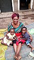 Ugandan woman and her grandchildren.jpg