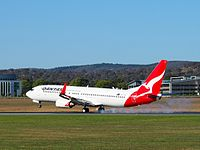 A Qantas Boeing 737 landing at Canberra Airport