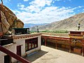 View from roof of Thagthok Gompa showing courtyard and wall paintings.jpg