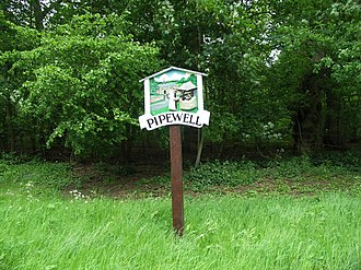 Pipewell - Village sign