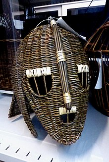 Colour photograph of a wicker rendering of the Sutton Hoo helmet