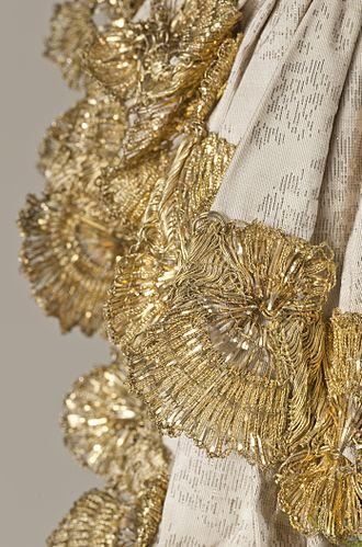 Trim (sewing) - Elaborate gold metallic lace trim c. 1760-65.