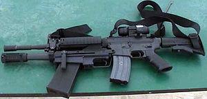 M26 Modular Accessory Shotgun System - Left side of M26 showing bolt handle.