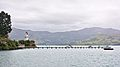 Yacht club wharf and historic Akaroa lighthouse.jpg