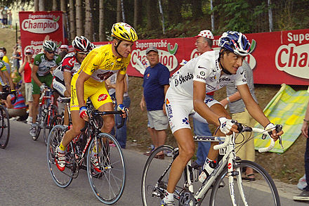 Voeckler in the yellow jersey at the 2004 Tour de France Yellow and White at the Tour de France (12930764174).jpg