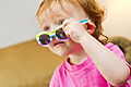 Young girl peering over sunglasses.jpg