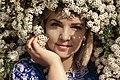 День Вишиванки. Молода україночка у вишитій синій сукні серед квітів 09.jpg