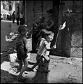"""Children In Naples, Italy"". Children playing in the streets. Photographed by Lieutenant Wayne Miller, July 1944. U.S. Navy Photograph, now in the collections of the National Archives.jpg"
