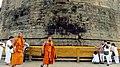 11. Religious Ceremony taking place at the Dhamek Stupa, Sarnath.jpg