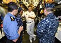 140706-O-ZZ999-126 mdr. Alex Kooiman, commanding officer of HMCS Victoria (SSK 876), speaks with Rear Adm. Yasuki Nakahata.jpg