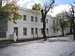 This interesting architectural complex of houses, which dates mainly from the 19th century, forms an integral part of the entire western side of Market Street, as well as of the historic core of Stellenbosch itself.