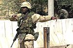 20020529 - Soldier directs traffic at Bagram AB in 2002.jpg