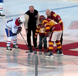 2011 Heritage Classic - Hall of Famers Bob Gainey and Lanny McDonald perform the ceremonial faceoff.