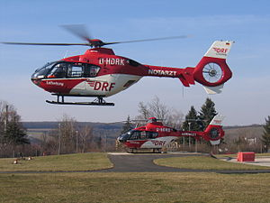 2 EC 135 flying and standing source DRF Luftrettung.JPG