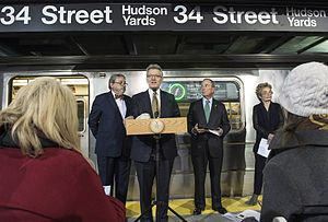 34th Street–Hudson Yards (IRT Flushing Line) - Then-mayor Michael Bloomberg stands to the right of the speaker at a ceremony at the station in December 2013
