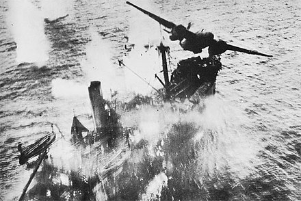 A U.S. A-20G bomber of the 3rd Attack Group bombs a Japanese merchant ship off New Guinea during the Battle of the Bismarck Sea, March 1943. A20BismarckSea.jpg