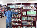 ASC Leiden - van de Bruinhorst Collection - Somaliland 2019 - 4442 - A young librarian arranging books. The National Library at Hargeysa, Somaliland.jpg