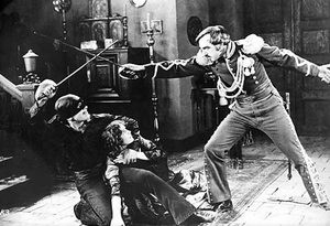 English: Douglas Fairbanks protects his leadin...