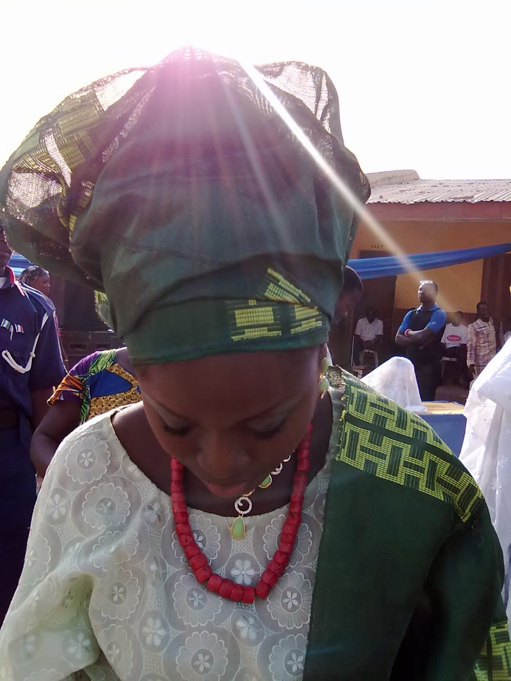 Yoruba Bride in Buba, with Ipele and the Gele headtie made from contemporary Aso Oke