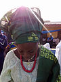 A Nigerian Yoruba bride in a lace Buba blouse, with Ipele and the gele headtie made from contemporary Aso Oke.jpg