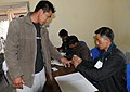 A Polling Officer administering the indelible ink to a young voter at village Khonoma (upper) of Kohima during the Nagaland Assembly Election on February 23, 2013.jpg