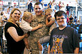 A Soldier, center, from 45th Infantry Brigade Combat Team, Oklahoma Army National Guard, is reunited with his family, during a homecoming ceremony in Oklahoma City, April 1, 2012 120401-A-ZW424-485.jpg