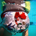 A Turtle Soup Lil' Swim Snapper reusable swim diaper proper fit iin a rear view.jpg