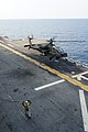 A U.S. Army AH-64D Apache Longbow helicopter assigned to the 4th Aerial Reconnaissance Battalion, 2nd Combat Aviation Brigade, 2nd Infantry Division lands aboard the amphibious assault ship USS Bonhomme Richard 140411-N-JH188-057.jpg