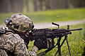 A U.S. Soldier assigned to Alpha Company, 1st Battalion, 114th Infantry Regiment, 50th Infantry Brigade Combat Team, New Jersey Army National Guard fires an M249 light machine gun during a live fire exercise 130814-Z-NI803-146.jpg