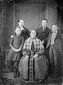 A group of one woman and four children NLW3364816.jpg
