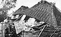 A native house after a typhoon (1923).jpg