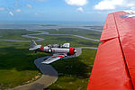 A retired U.S. Navy T-6 Texan trainer aircraft, left, flies beside a retired Navy C-45 Expeditor during the Salute from the Shore Independence Day event July 4, 2013, near Myrtle Beach, S.C 130704-F-CX352-016.jpg
