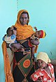 A woman pictured with her children, recovering from malnutrition at a health clinic in southern Ethiopia (6021951300).jpg
