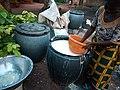 A woman sifting fermented cassava.jpg