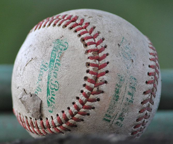 English: A baseball that has been extensively used
