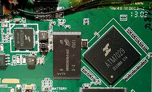 Actions Semiconductor - Close-up of the Ainol Hero 10 II PCB showing the Actions Semiconductor ATM7029 SoC ASIC and the ATC2603A Mixed signal ASIC.