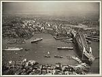Aerial view of Sydney and Circular Quay on the day of the official opening of the Sydney Harbour Bridge, 19 March, 1932 (6174053762).jpg