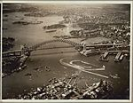 Aerial view of the speed boat display after the official opening celebrations of the Sydney Harbour Bridge, 19 March, 1932 (6173525847).jpg