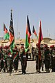 Afghan National Army soldiers with the 1st Special Operation Brigade color guard stand in formation Aug. 20, 2013, during the brigade's opening ceremony at Forward Operating Base Thunder in Paktia province 130820-A-NQ567-060.jpg