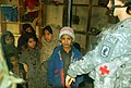 Afghan children line up to be seen by Army medic at Forward Operating Base Naray.jpg