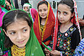 Afghan girls in traditional clothes-May 2011.jpg