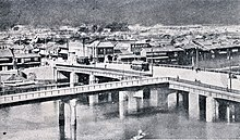 Photograph of the original Aioi Bridge from above, illustrating its T shape.