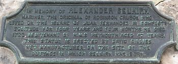 Bronze plaque in memory of Selkirk affixed to a building