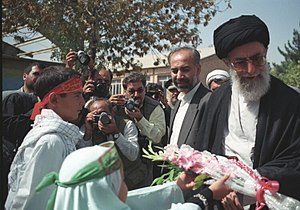 Generosity - Ali Khamenei being welcomed in the city of Birjand, Iran by children bearing flowers, 1999