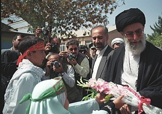 Generosity - Ali Khamenei being welcomed in the city of Birjand, Iran by children bearing flowers, 1999