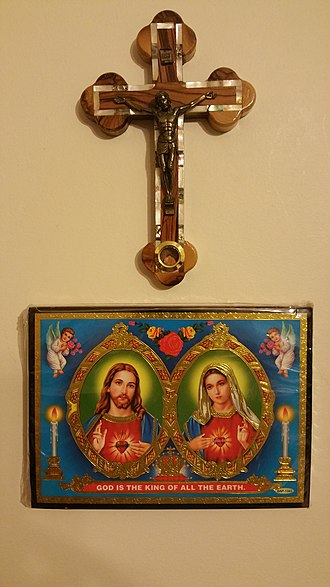 Alliance of the Hearts of Jesus and Mary - A crucifix, as well as a plaque of the Alliance of the Hearts of Jesus and Mary, hanging on a wall
