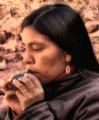 Amerindian woman playing an inca ocarina.png
