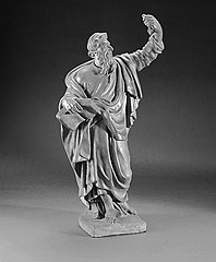 St. Paul, holding an open book in his right hand against his hip and the hilt of the sword (?) in his left hand