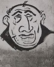 Wall graffiti of a man with stereotypical Jewish facial feathres